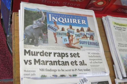 Philippines, Manila - naked girls sells newspaper