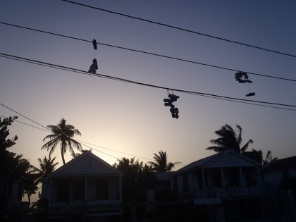 Caye Caulker - hanging shoes
