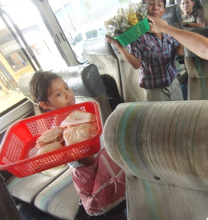 Chicken bus with food sellers