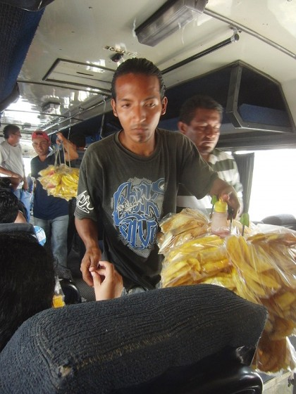 Chicken bus in Honduras with fried bananas and chili