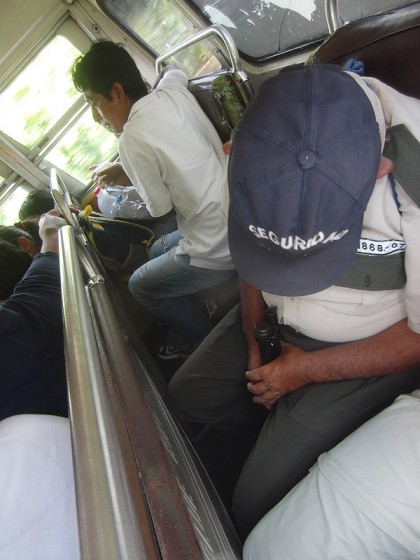 Chicken bus: police sleeping with shotgun in his face
