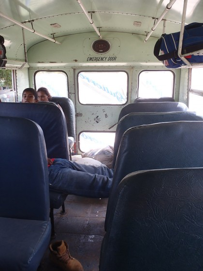 Chicken bus, sleeping man