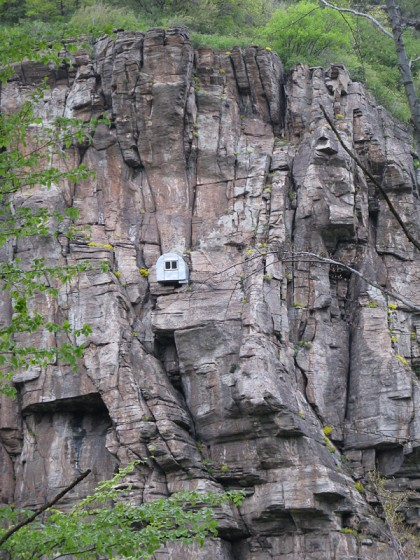 Climbing hut on mountain wall