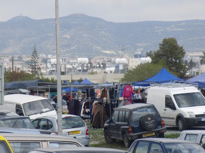 Market & parked cars, with mountains in the background