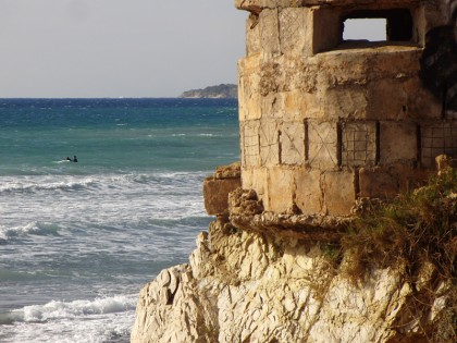 Military ruin in Tarifa, with windsurfing board & paddler