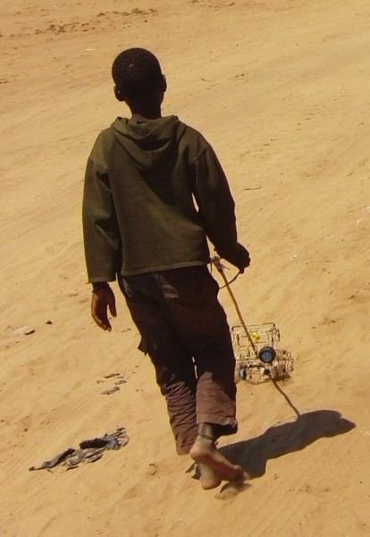 Mozambique boy with car toy