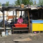 romani woman washing in camp