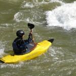 Yellow kayak in stream