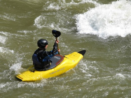 Yellow kayak in stream