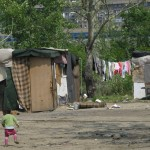 young child walking in gypsy camp
