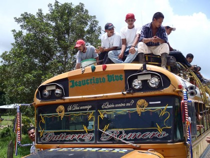 Chicken bus with people on roof