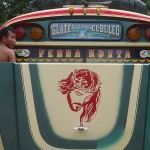 Chicken bus Rabinal (Guatemala) with Jesus hood
