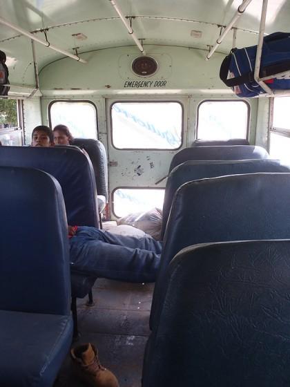 Chicken bus, sleeping man