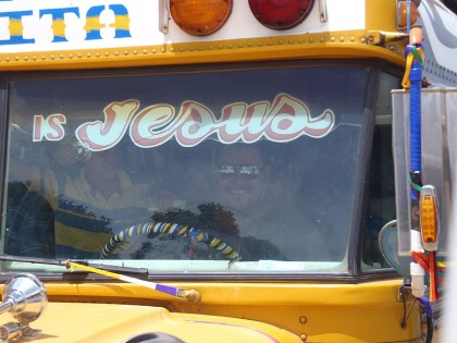 Chicken bus with smiling man & Jesus