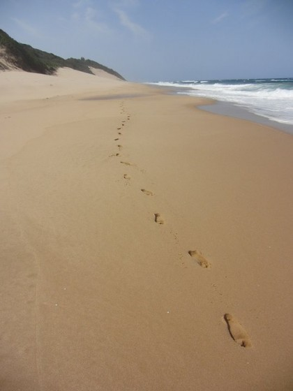 Footsteps in sand beach