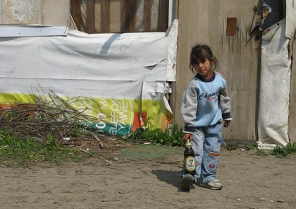 gypsy kid with beer bottle