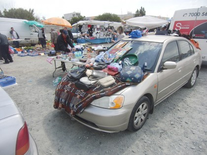 Car used as a table for selling things