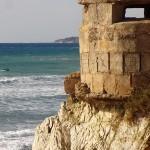 Military ruin in Tarifa, with windsurfing board & paddler