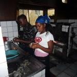 Preparing seafood in kitchen