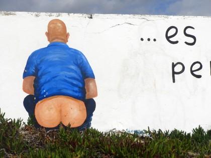 Graffiti of a man shitting in the grass, Tarifa